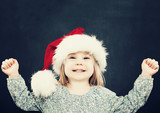 Small Child Girl Having Fun. Christmas Portrait on Background wi