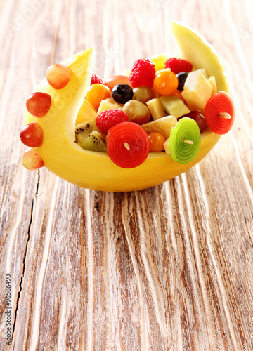 Colorful healthy fresh fruit salad in a boat