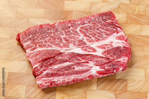 Poster Beef chuck steak on chopping board