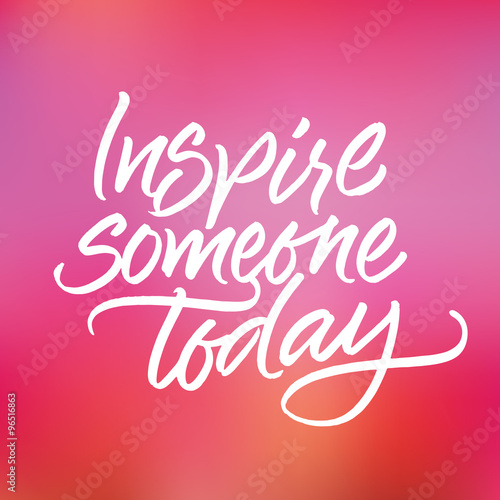 Poster Inspirational phrase 'Inspire someone today' on blurred pink and violet background. Handwritten brush calligraphy.