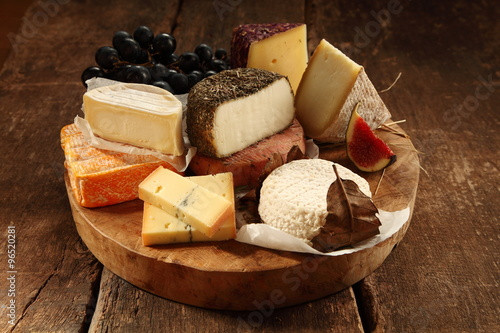 Assorted cheeses on a rustic platter