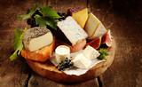 Fototapety Gourmet cheese platter on a rustic buffet
