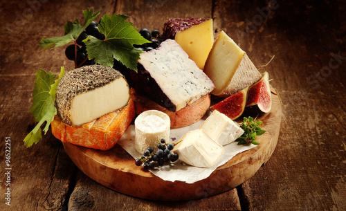Gourmet cheese platter on a rustic buffet