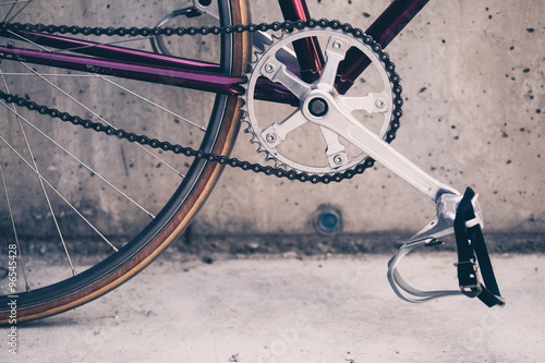 Staande foto Fiets Road bicycle and concrete wall, urban scene vintage style