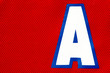 Letter A of an Assistant Captain on a hockey jersey, close up