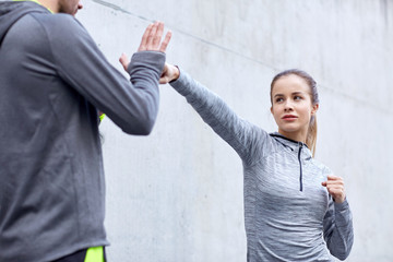 woman with coach working out strike outdoors