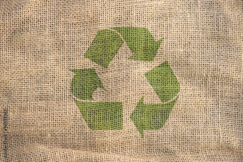 Poster Recycle symbol on burlap textile