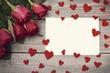Obrazy na płótnie, fototapety, zdjęcia, fotoobrazy drukowane : Piece of paper in the middle of felt hearts