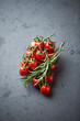 Cherry tomatoes on the vine and rosemary