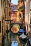 Narrow channel street in Venice, Italy