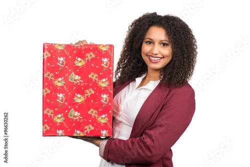 frau h lt ein weihnachtsgeschenk stock photo and royalty. Black Bedroom Furniture Sets. Home Design Ideas