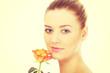 Obrazy na płótnie, fototapety, zdjęcia, fotoobrazy drukowane : Smiling woman with fresh rose.