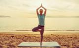 Girl in yoga pose of tree on beach - Fine Art prints