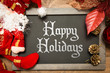 Blackboard with the text: Happy Holidays in a christmas conceptual image