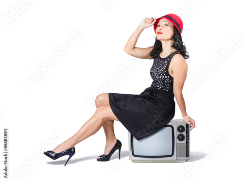 Plagát Young asian woman sitting on 70s tv set