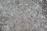 close up of wet gray gravel road or ground