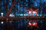 Traditional Chinese pavilions in Lazienki Park in Warsaw at nigh
