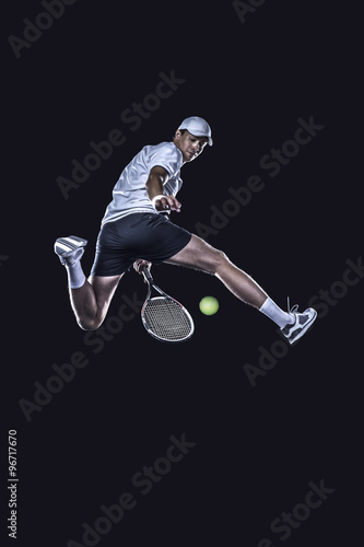 Tennis player reaching for the hard ball isolated Poster
