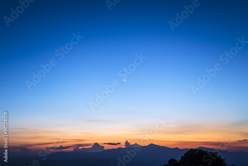Poster twilight sky with the crescent moon in winter at the north of Thailand