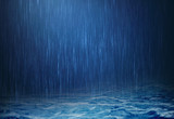 Fototapety rain water drop falling to the surface water in rainy season