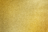 close up golden glitter texture for glamour holiday background