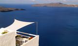 Fototapety Beautiful balcony in Oia village, Santorini island, Greece