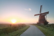 beautiful sunrise behind windmill
