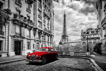Artistic Paris, France. Eiffel Tower seen from the street with red retro limousine car. © Photocreo Bednarek
