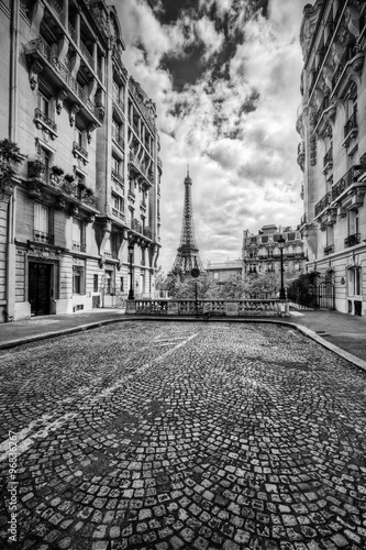 Poster, Tablou Eiffel Tower seen from the street in Paris, France. Black and white