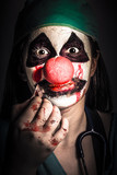 Horror clown girl in silence with stitched lips