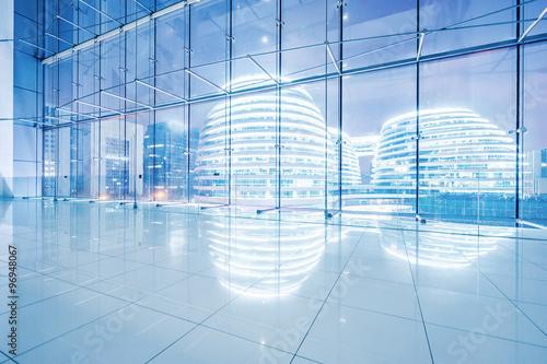 night scene of modern buildings through windows - 96948067