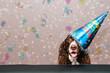Obrazy na płótnie, fototapety, zdjęcia, fotoobrazy drukowane : happy dog wearing a new year party hat with confetti falling