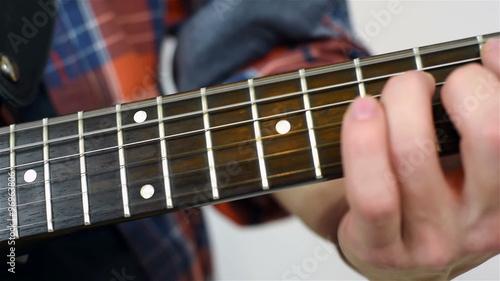 Keuken foto achterwand Antwerpen Man Playing On A Electric Guitar, Close Up