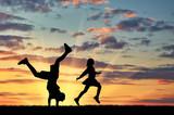 Fototapety Silhouette of happy children
