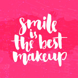 Smile is the best makeup. Inspirational quote handwritten with white ink and brush, custom lettering for posters, t-shirts and cards. Vector calligraphy on bright pink grunge background