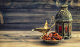 Ramadan lamp and dates on wooden background. Oriental lantern - 97000675
