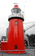 red lighthouse with B/W background.