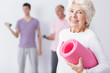 Leinwanddruck Bild - Happy elderly woman at gym