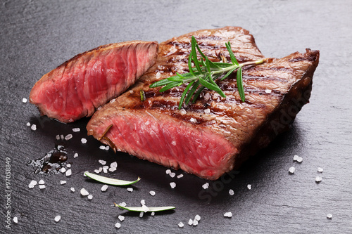 Plagát, Obraz Grilled beef steak with rosemary, salt and pepper