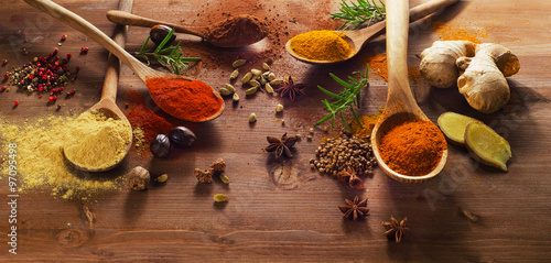 Fototapeta Spices and herbs on wooden table.
