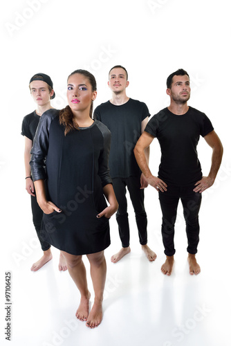 Poster Music band studio portrait. Musicians posing in studio over whit