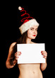 Girl wearing funny red spiral Santa hat