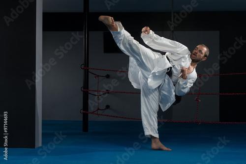 Fototapeta Black Belt Karate Expert With Fight Stance