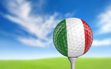 Golf ball with Italy flag colors sitting on a tee