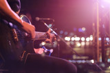 Fototapety Guitarist on stage for background, soft and blur concept