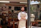 Proud cafe owner standing in the doorway - 97271066