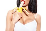 Fototapety Sexy woman eating banana