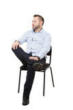 man sitting on chair. Isolated white background. Body language. gesture. Training managers. sales agents.  legs crossed, fixed arm. misses. dominant position