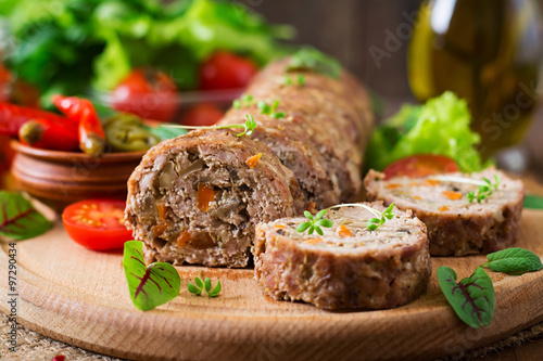 Minced meat loaf roll with mushrooms and carrots Poster