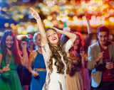 Fototapety happy young woman dancing at night club